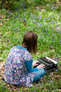 documents for psychotherapy, counseling and coaching clients being filled out in field of bluebells